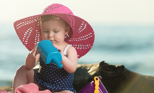 little-girl-on-beach-with-hat