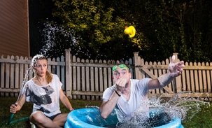 alec and martha jump in mini pool with rubber duckie