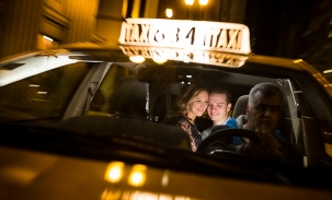 ally and nick riding in back of taxi cab
