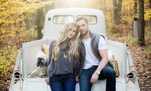 couple in back of old truck