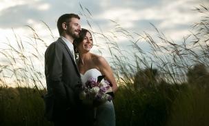 wedding couple pose at taltree arboretum