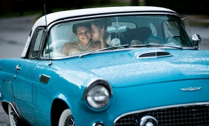 bride and groom wedding day in vintage thunderbird