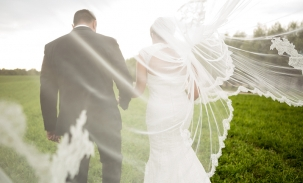 bride-and-groom-walking-with-veil