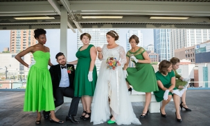 bridal-party-posing-at-train-station