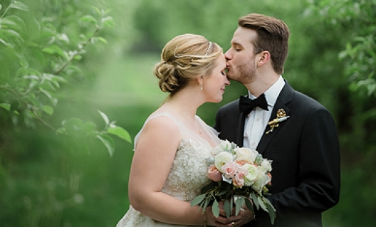 bride and groom in orchard fields