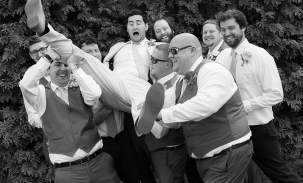 groom-carried-by-groomsmen