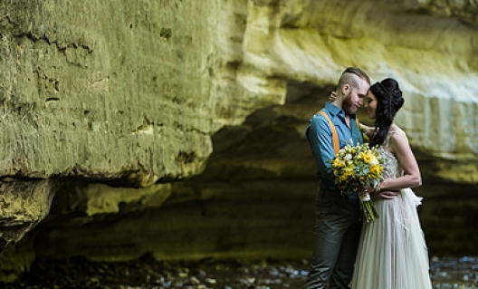 faith and tyler by canyon wall
