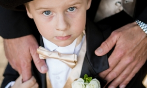ring-bearer-standing-by-dad