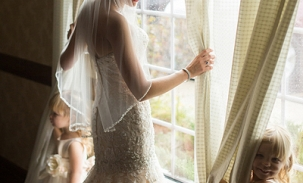 alyssa-in-wedding-dress-with-kids-by-the-window