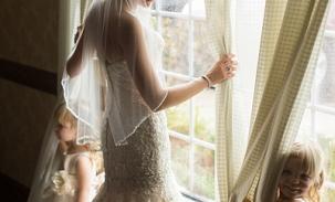 alyssa-in-wedding-dress-with-kids-by-the-window