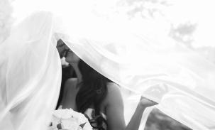 bride-and-groom-kiss-under-veil