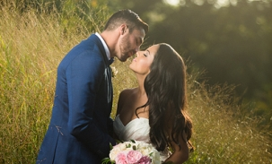 bride-and-groom-kiss-in-tall-grasses